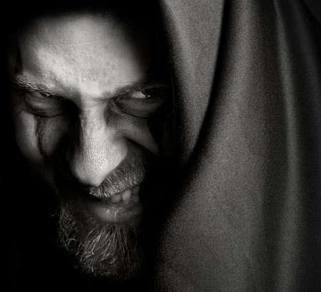 creepy monster: Malvagio sinistro con ghigno malefico Archivio Fotografico