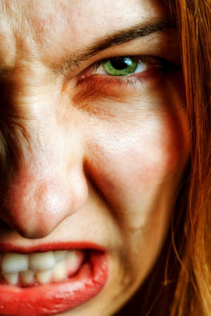 emo: Face of angry woman with evil scary expression