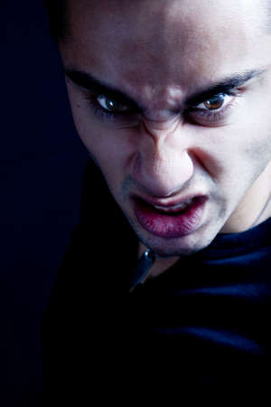 Frown of scary sinister evil vampire male photo