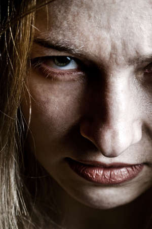 diabolic: Close up on angry evil upset scary woman