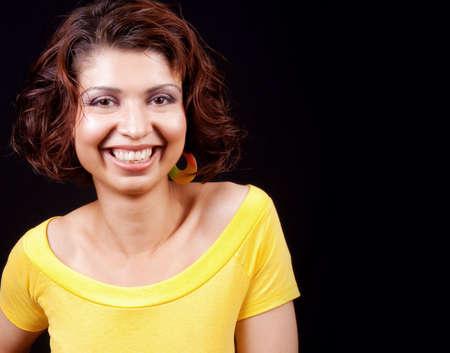 One happy joyful woman isolated on black background photo