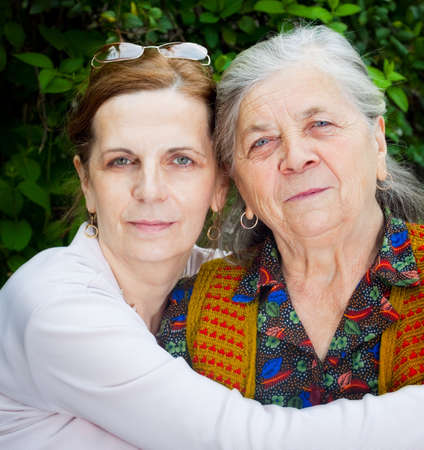 daughter: Family portrait - middle age daughter and senior mother Stock Photo
