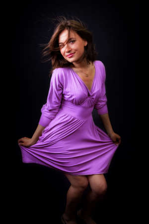 Happy woman with elegant violet dress photo