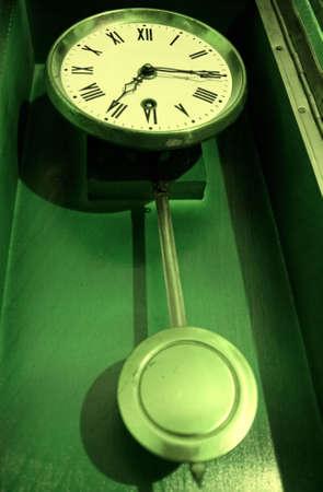 One antique old retro pendulum clock Stock Photo - 5871156