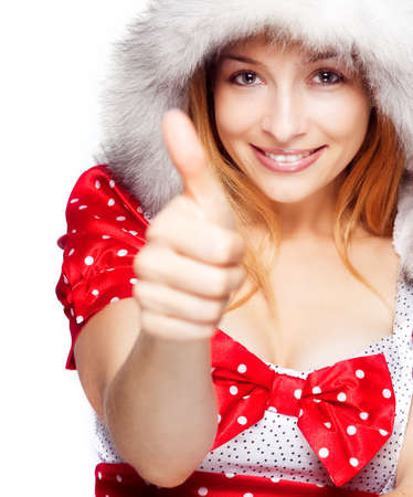 Winter portrait of happy woman showing ok sign photo