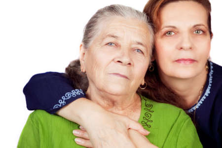 mature old generation: Family portrait - happy daughter and her old mother