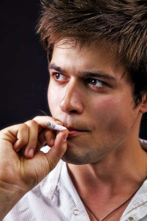 One young sexy man smoking a cigarette