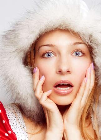 Surprise Christmas concept - amazed cute woman Stock Photo - 5944327