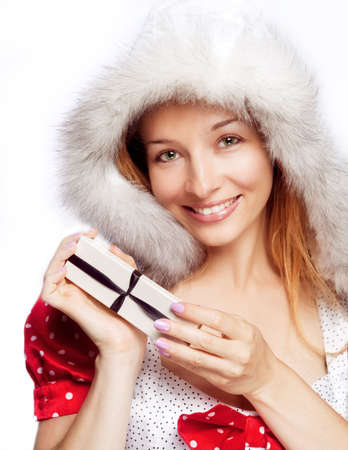 Happy young woman with Christmas present over white photo