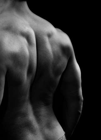 creative strength: Man with big muscular back in black and white style Stock Photo