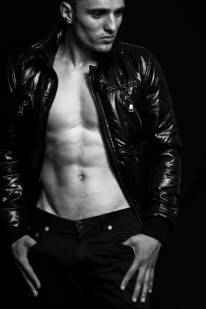 Fashion - handsome sexy man with muscular abdomen photo