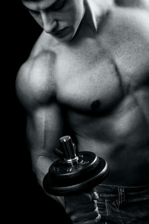 Bodybuilder in action - muscular powerful guy lifting weights Stock Photo - 6181459