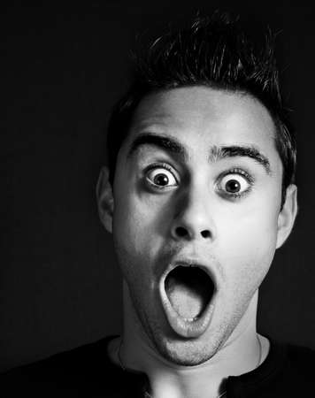 is astonished: Amazed and shocked funny young man