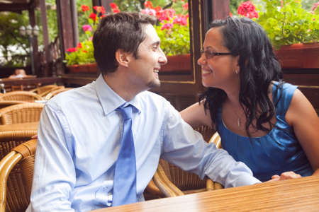 Happy couple at restaurant table photo