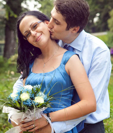 young couple hugging kissing: Cute couple in a kiss and hug romantic moment