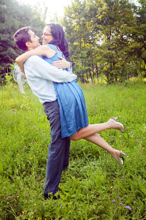 lovers embracing: Embrace of happy cute couple outdoor Stock Photo