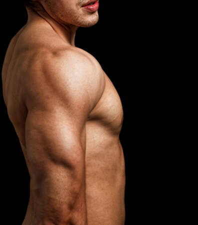 Triceps and shoulder of male with muscular fit body photo