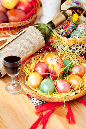 wine colour: Easter colorful eggs with wine bottle and glass