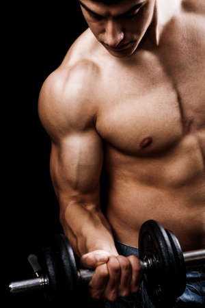 Fitness - powerful muscular man lifting weights Stock Photo
