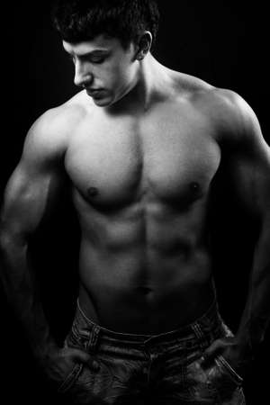 Dark portrait of guy with muscular body Stock Photo - 6349572