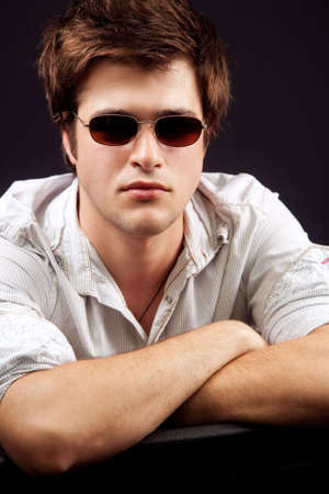 Portrait of handsome young man with sunglasses photo