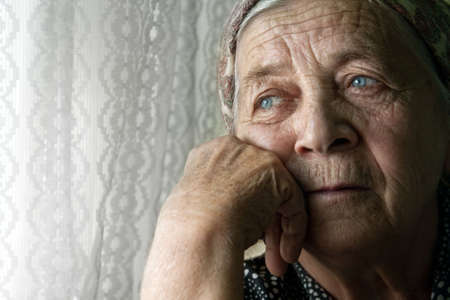 Portrait of sad lonely pensive old senior woman photo