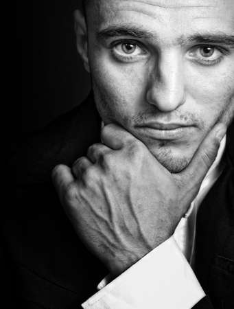 Portrait of one handsome elegant masculine young man photo