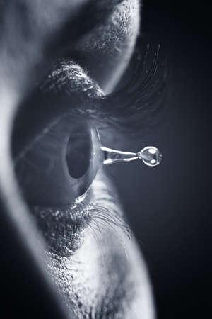 Macro on eye with tears water droplet Stockfoto