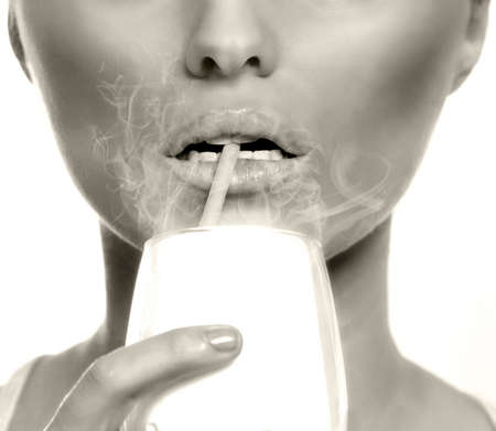 inhaling: Passive or second hand smoking concept - woman inhaling smoke at the bar