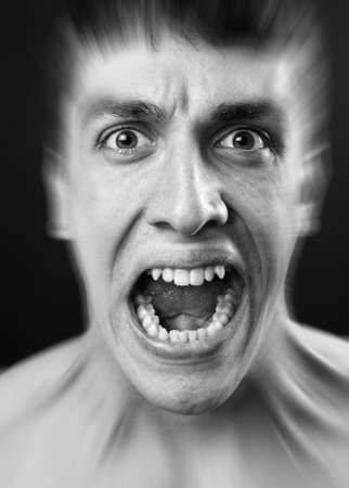 Loud scream of scared frighten young man Stock Photo