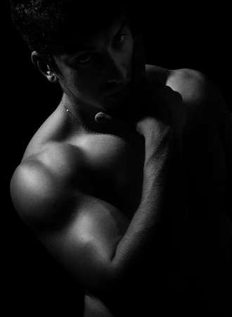 Dark artistic portrait of sexy muscular nude man Stock Photo - 6604532