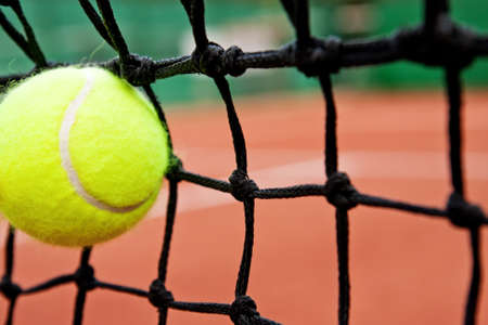 Failure or defeat concept - tennis ball in the net