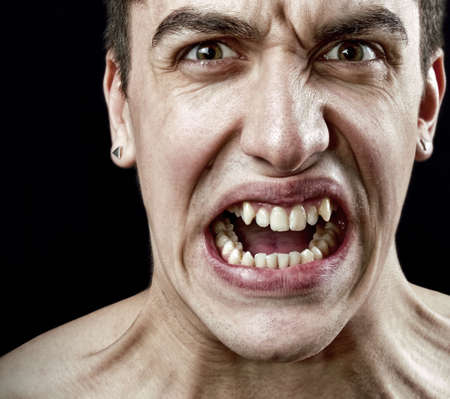 Stress concept - grimace of angry furious stressed man photo