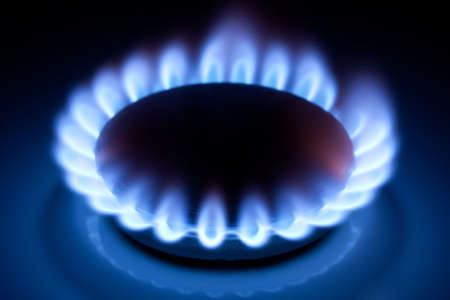 methane: Methane blue flames at kitchen cooker in the dark