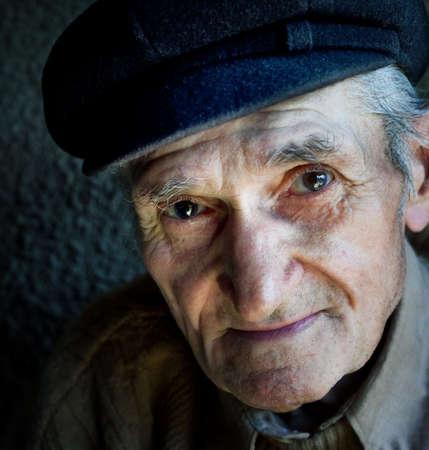Artistic portrait of friendly senior old male photo