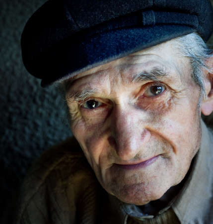 expressive: Artistic portrait of friendly senior old male Stock Photo