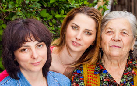 mature old generation: Family portrait - happy daughter granddaughter and grandmother