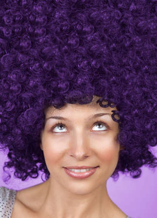 Joyful young woman with funny hair coiffure photo