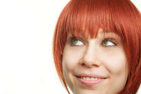 Face of young redhead woman having an idea Stock Photo - 6668827