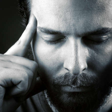 sexual health: Man expressing headache or think meditation concept Stock Photo