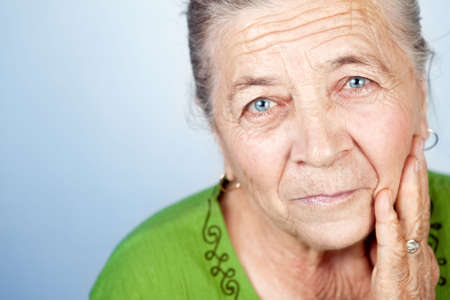 Portrait of content beautiful old senior lady Stock Photo - 6668866