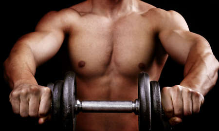 Powerful muscular man holding metal workout weight photo