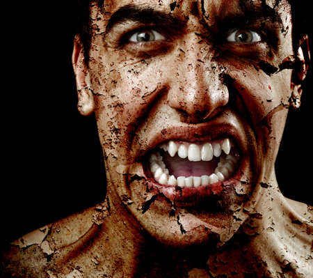 Spooky sinister man with aged cracked peeling skin Stock Photo