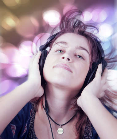 Active young teen woman listening modern music photo