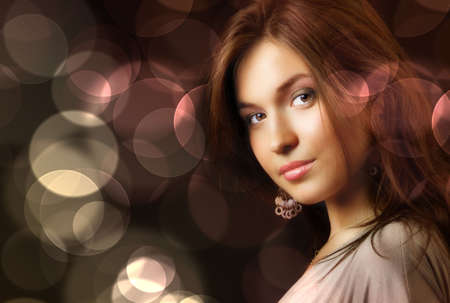 light complexion: Beautiful young woman and glamour city night lights Stock Photo