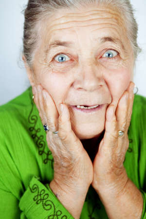 Excited senior woman with surprise expression on her face photo