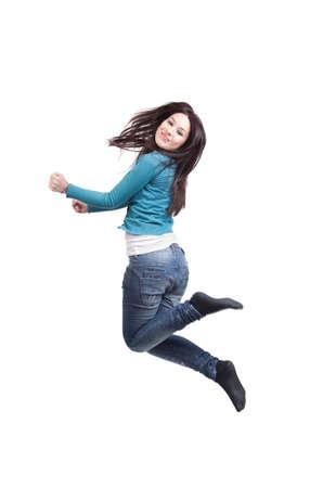 Jump of happy joyful young woman on white photo