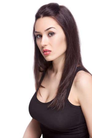 busty: Una mujer femenina sexy aislada sobre fondo blanco Foto de archivo