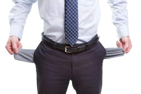 hands in pockets: Broke business man with empty pockets isolated on white