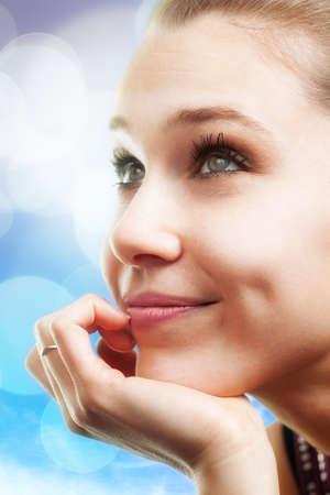 Bright portrait of pensive happy beautiful young woman Фото со стока